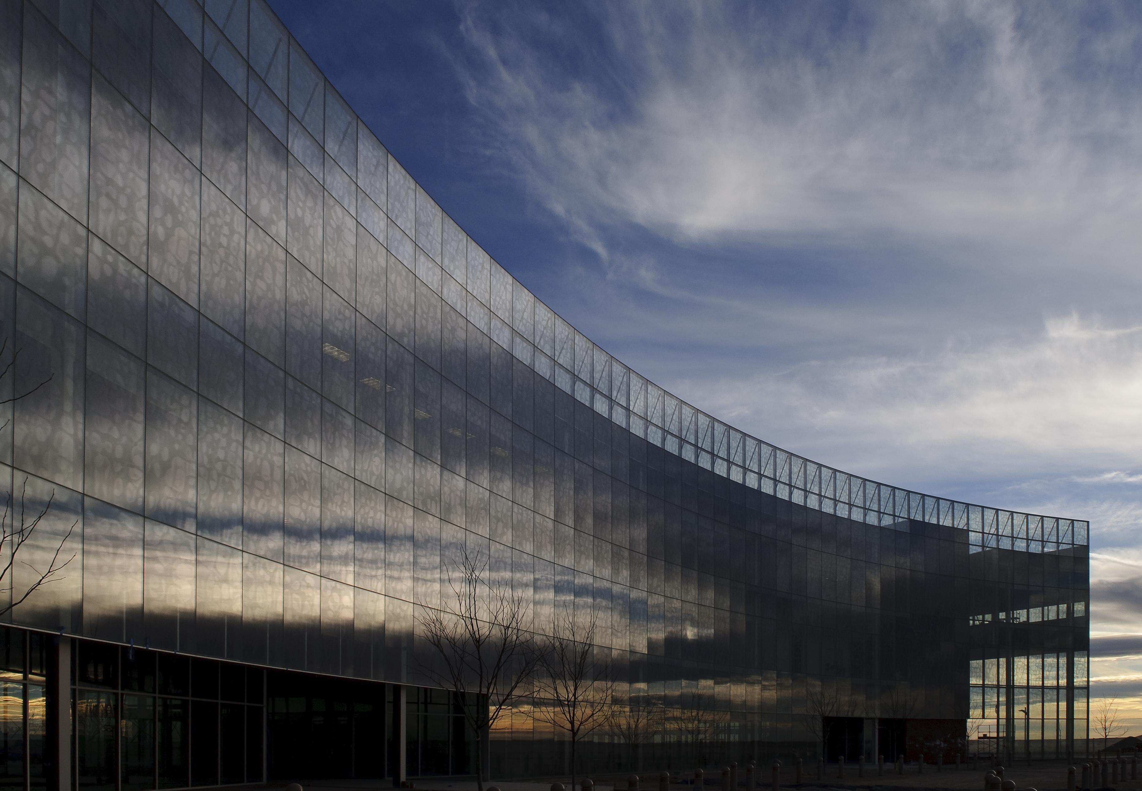 Mesa Del Sol Town Square, Albuquerque, New Mexico   Glazing contractor: Southwest Glass and Glazing   Architect: Antoine Predock Architects. PC   Glass: PPG Solarban 60 with custom silkscreen (Bone Marrow)